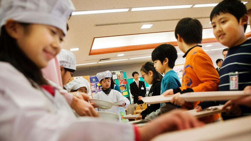 No junk food here: Third-graders serve lunch to their classmates Jan. 16 at Umejima Elementary School in Adachi Ward, Tokyo.