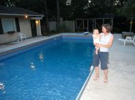 Us before a wedding and our FINISHED POOL!