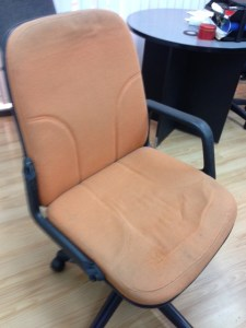 The infamous, one-armrest orange chair