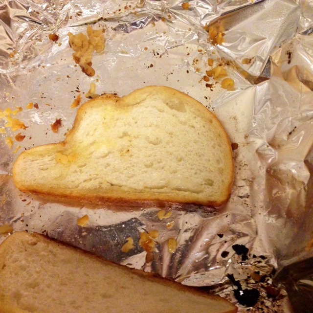 A slice of garlic bread shaped like Kentucky
