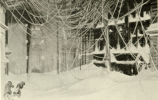 Telegraph and electrical lines dangle dangerously overhead during the Blizzard of 1888.