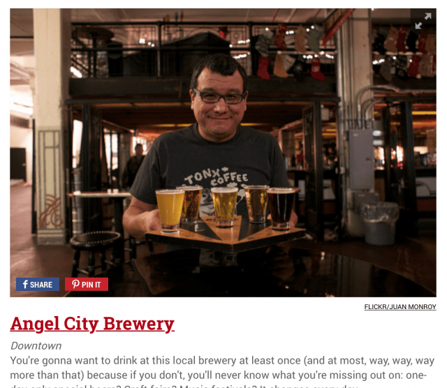 I hold a flight of five beers at Angel City Brewing