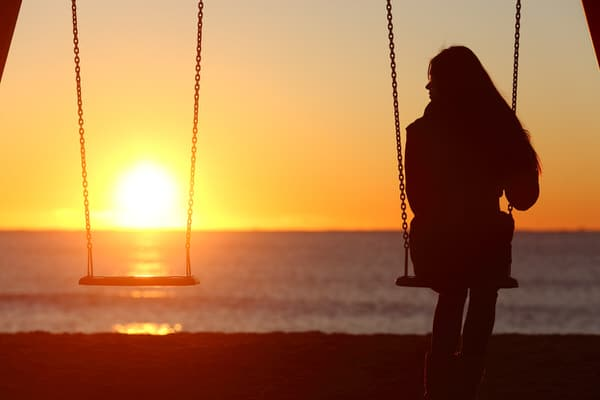 midlife loneliness+woman-on-swing