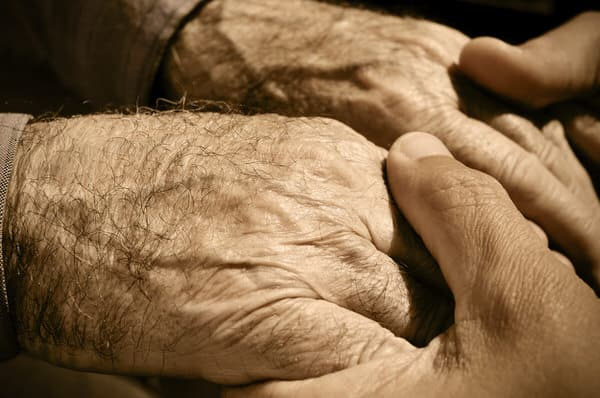 family caregiver+old-and-young-hands