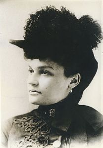 300px-Belle_Brezing_in_a_feather_hat_(circa_1895)