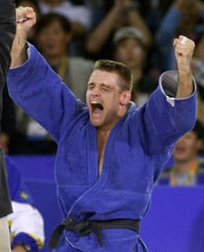 Mark Huizinga of the Netherlands celebrates his victory over Carlos Honorato of Brazil to win the gold medal  in the 90kg judo at the Olympics in Sydney, Australia, Wednesday Sept. 20, 2000.  (CP PHOTO/Kevin Frayer)