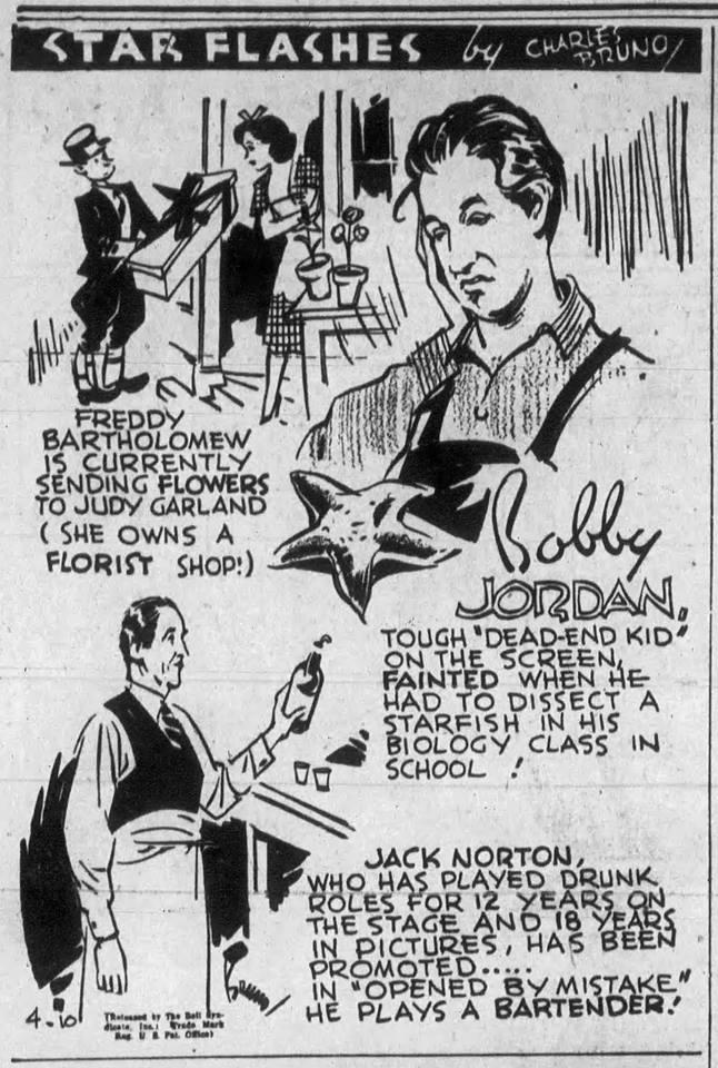 Freddie Bartholomew gives Judy Garland flowers