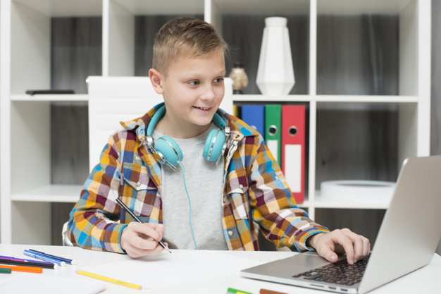 boy-doing-homework-with-laptop_23-2148019097