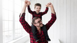 man-holding-son-fathers-day-front-chalkboard_23-2147790849