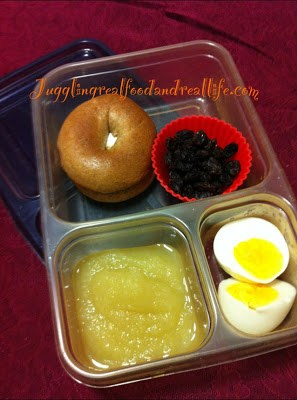 Mini Bagel with Cream Cheese, Raisins, Apple Sauce (no sugar added) and Hard Boiled Egg