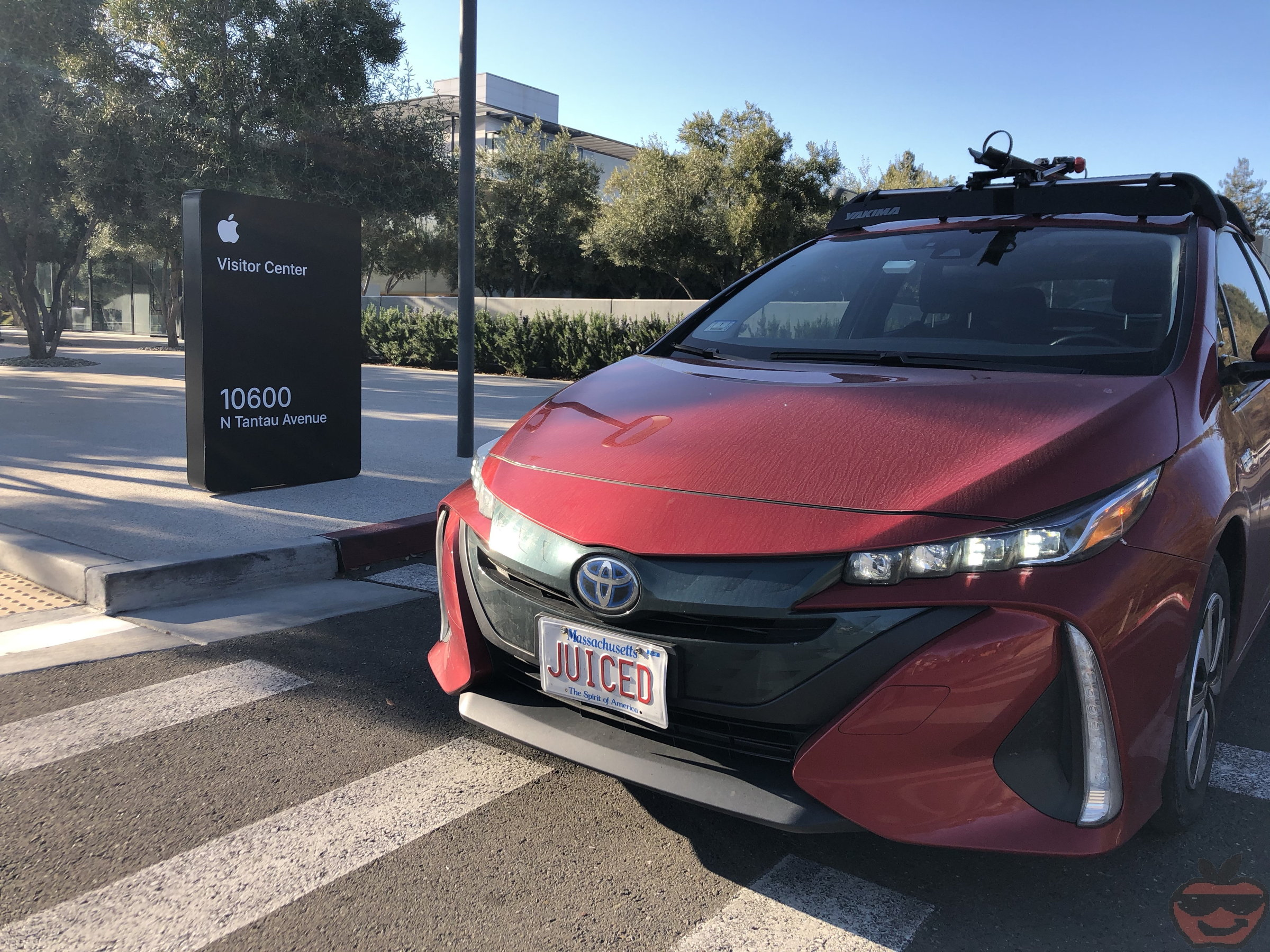 Ken's red Toyota Prius Prime outside the Apple visitor center