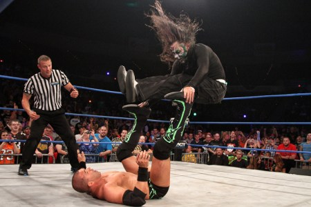 Jeff Hardy (with troll hair) drops both legs on Kazarian