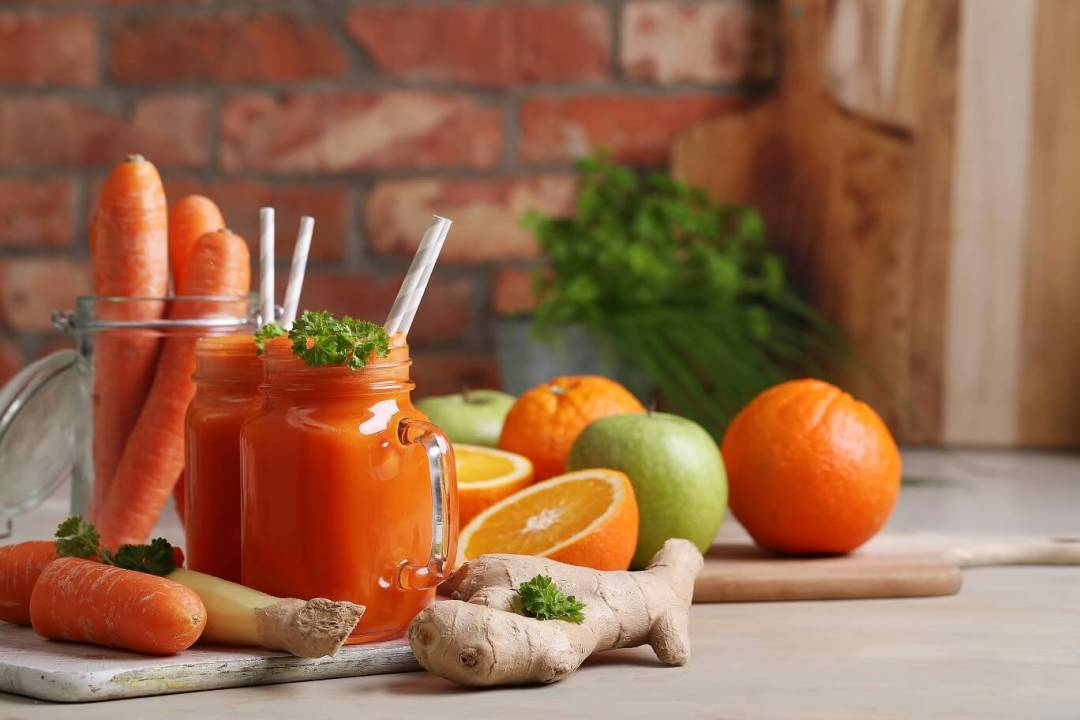 Carrot Juice with Oranges, apple and ginger, Drink, kitchen. Healthy carrot juice
