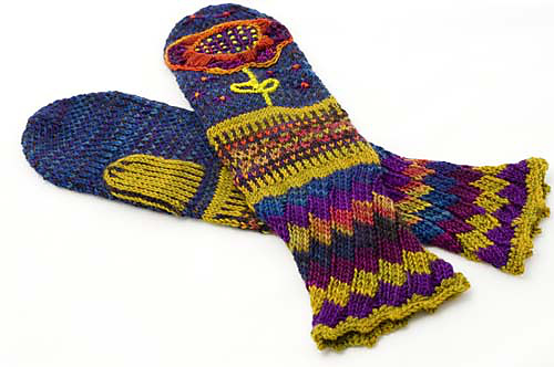 Long pair of mittens with embroidery and colour work.