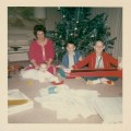 McGilvray Family Christmas, 1964. Mom with my older brothers Brian and Mike, who were enjoying the greatest gift ever: their six-month old baby brother - me!