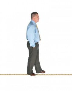 Businessman walking on tightrope
