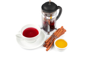 Cup of tea from blueberry and chabrets with cinnamon sticks, and honey