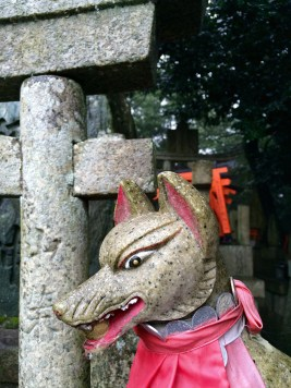In Fushimini Inari there are thousands of foxes like this one, symbolizing messengers