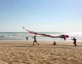 Kids flying a kite at Kuta