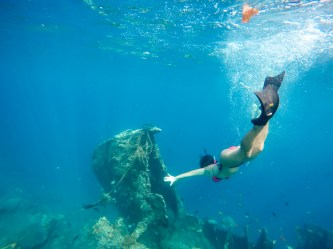 Jules dives to get a closer look at the Japanese wreck