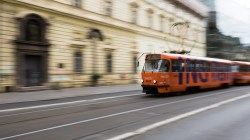 A träm whizzes through Prague's empty early morning Sunday streets (1/15s, f16, ISO 200)