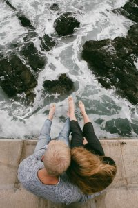 Couple sitting by river