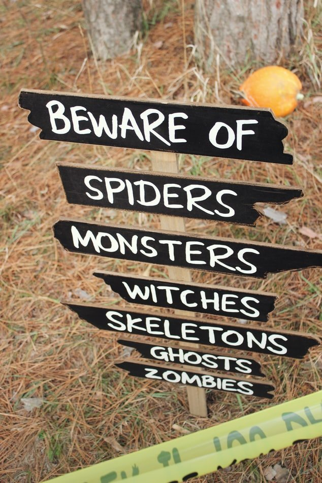 Beward of ghosts and monsters sign