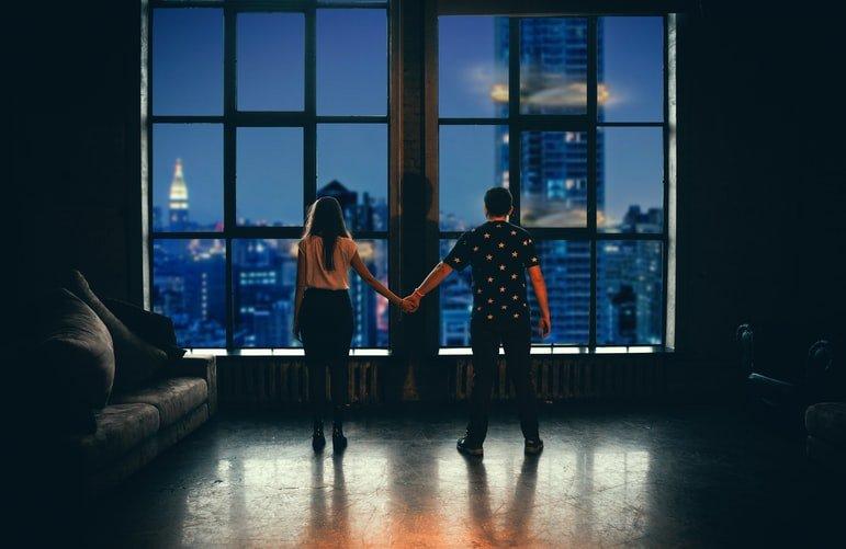 Couple alone in a dark room