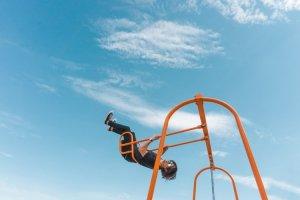 Boy flying high on a swing