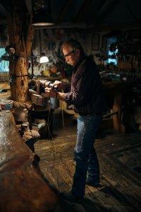 Man making rifles