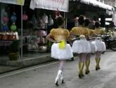 Parade girls baton their way down the village road.