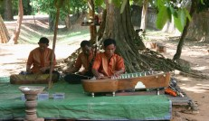 Men Play Traditional Music At the Rear of the Lady Temple