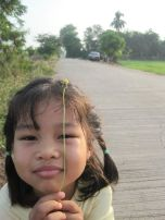 My Niece, Pissa, Posing as We Stopped to Look at the Sugar Cane and Rice Fields
