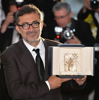 CANNES, FRANCE - MAY 24: Turkish drama Winter Sleep of Nuri Bilge Ceylan (posing) wins Palme d'Or , the Golden Palm of 67th Cannes Film Festival on May 24, 2014. (Photo by Mustafa Yalcin/Anadolu Agency/Getty Images)