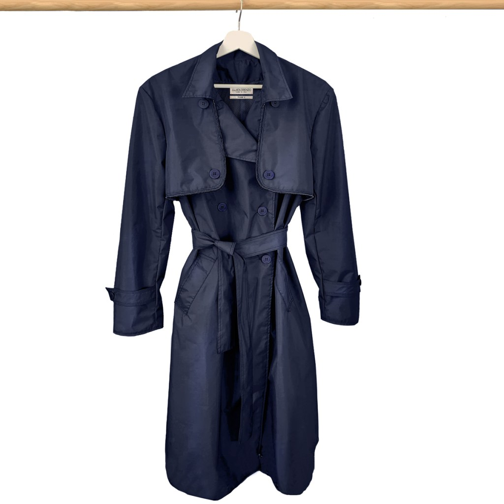 Front view of the navy blue raincoat with yellow stripe on the bottom of raincoat. London style upcycled raincoat by JDL collection.
