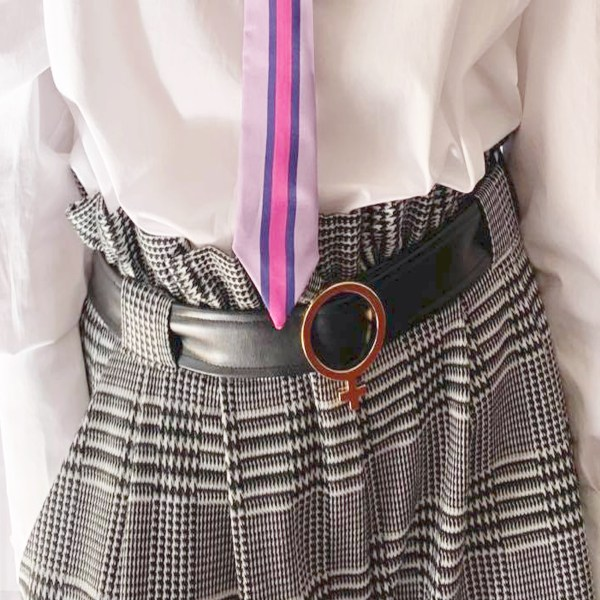 hand in jacquard shorts womens. Model is wearing a metallic neck tie and leather black belt with a white gold Venus belt buckle. Wearing a white blouse with puffed sleeves.