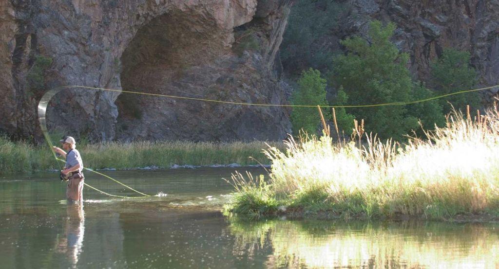 Man fly fishing in river Colorado