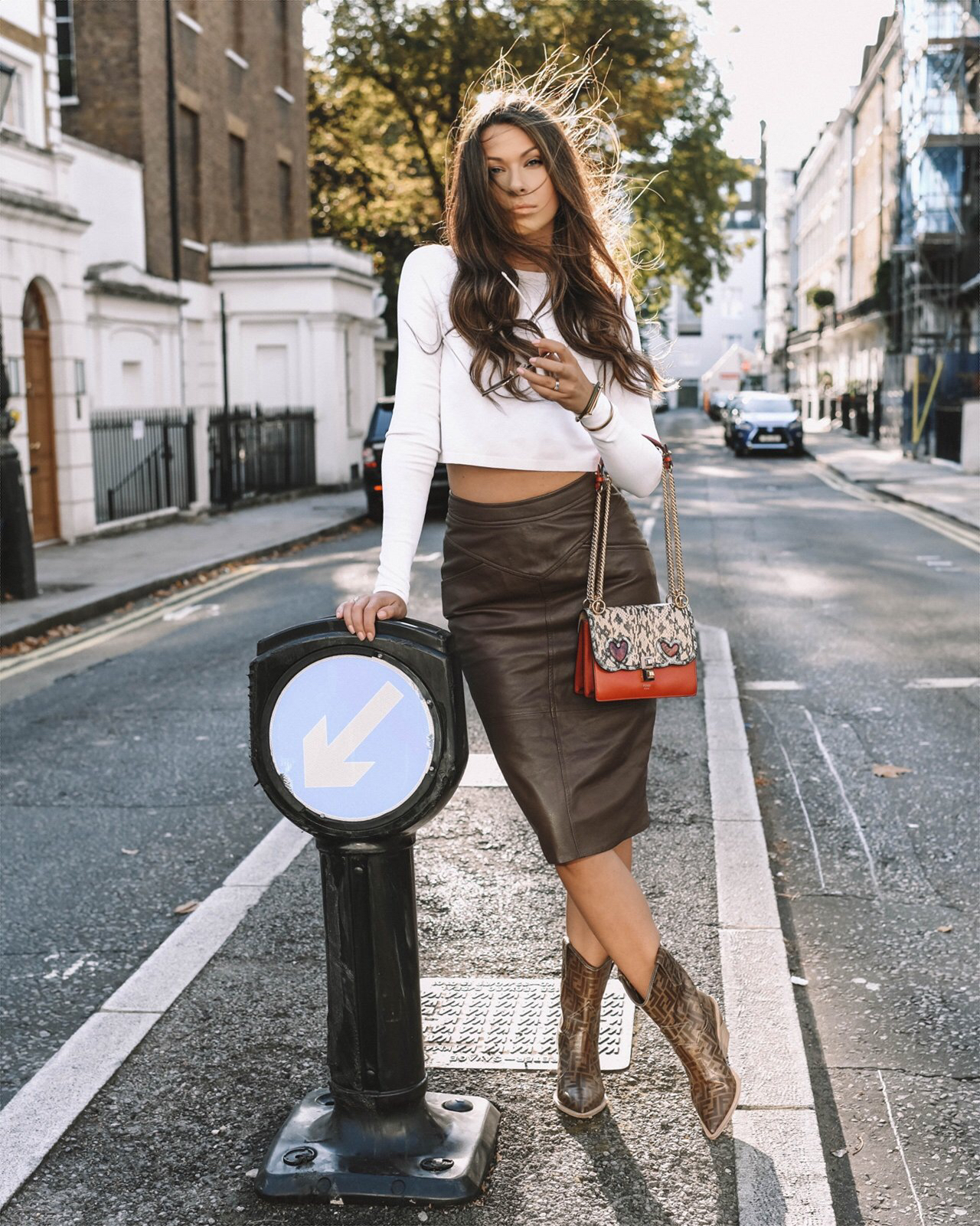 brown leather skirt and fendi accessories