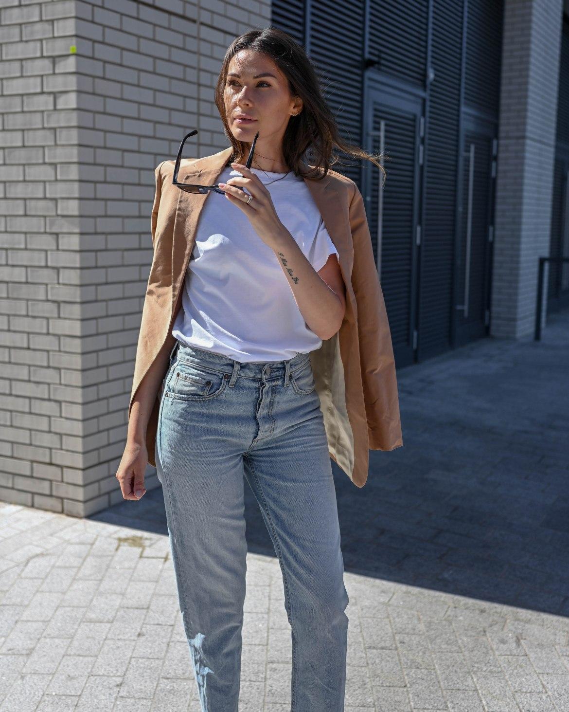 beige blazer, blue jeans and white tee