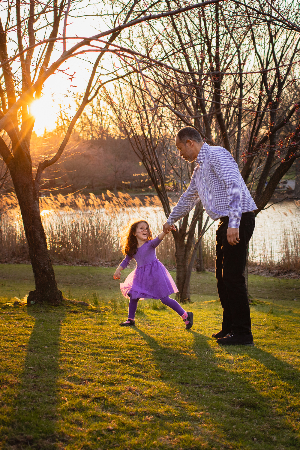 playful spring time father daughter lifestyle photo