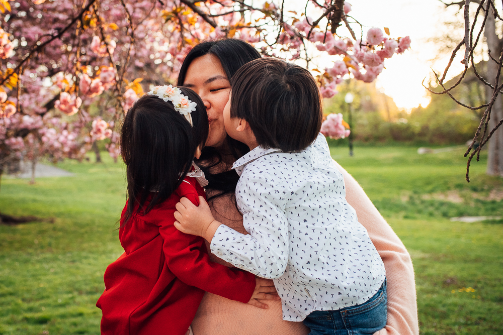 mom in embrace with her kids
