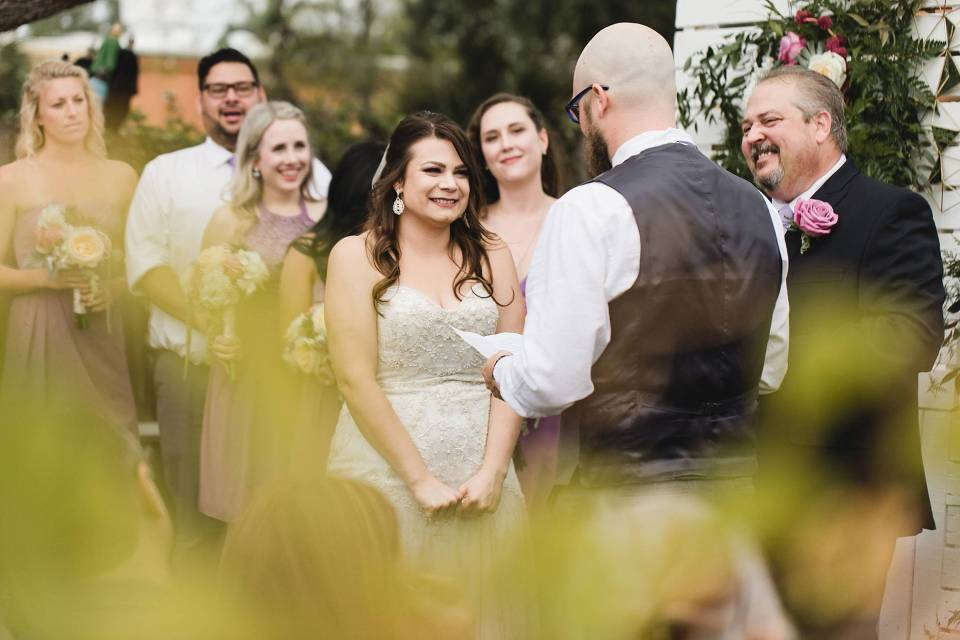 Bride listening to Groom's vows at omaha ceremony