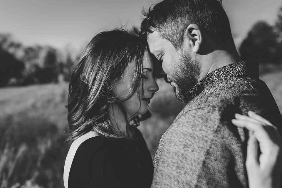 couple touching foreheads at omaha engagement session