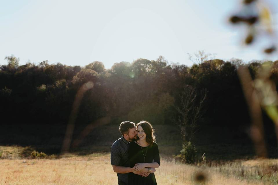 couple embracing and laughing at engagement session in neale woods