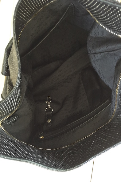 Anya Hindmarch black leather tote with gold perforations