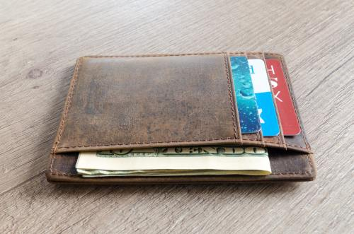 leather wallet with bills and cards