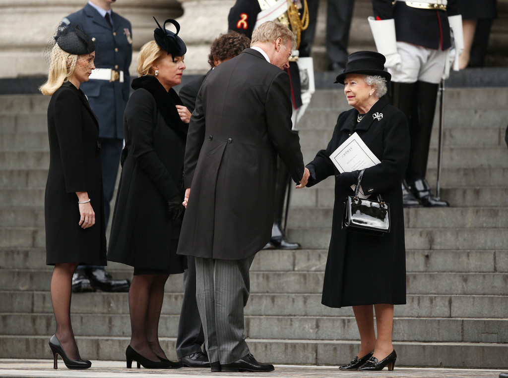 Queen Elizabeth Ii And Prince Philip Attend The Funeral Of
