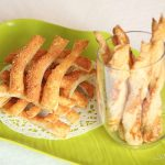parmesan sticks on green plater and in wine glass