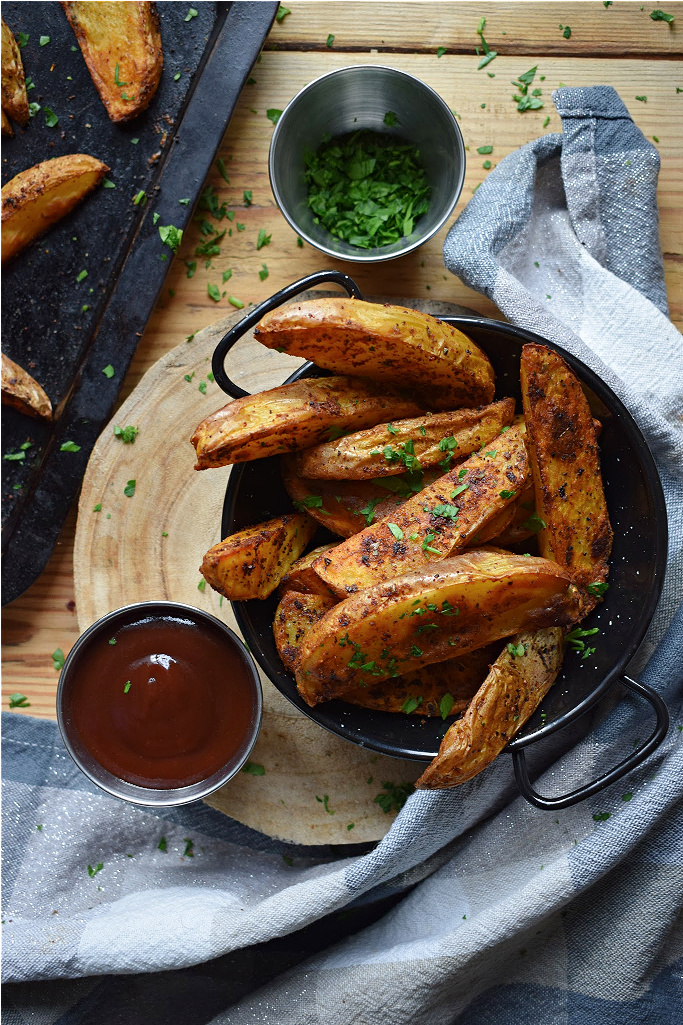 over head table view of spiced potato wedges