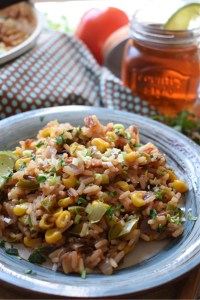 Mexican Rice on a plate with a drink in the background